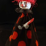 creepy clown in red